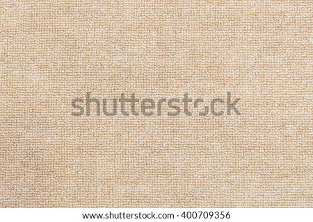 the texture background of the carpet,the carpet texture with the clean condition.The light brown carpet texture background in the meeting room.Close up of the carpet texture background.
