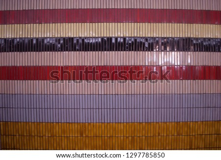 The texture is multi-colored, tile, rectangular. Colorful . White, red, yellow, blue colors. Horizontal lines, Soviet architecture. The background. - Image #1297785850