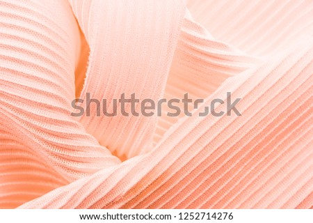 The texture is ribbed, the direction is different, the fabric is pleated on the background screen, close-up. Color is soft pink ストックフォト ©