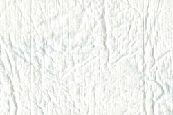 The texture is similar to cotton wool, white, uneven. The surface of the fabric is uneven, not smooth, like a medical diaper. Cotton.