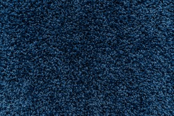 The texture of a blue carpet. Fleecy surface. Background