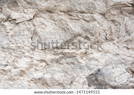 The texture of a light stone wall that partially collapses. Background for the banner. The basis for design