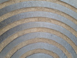 The texture of a metal plate with a radial pattern.