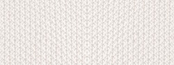 The texture of a thickly woven sweater. White winter background.