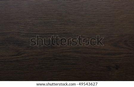 The texture of dark wood.