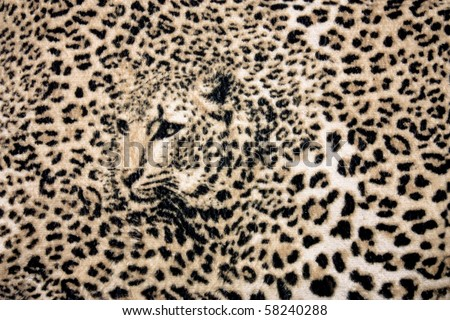 The texture of fabric with the image of a leopard background
