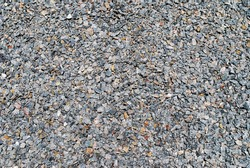 The texture of fine gray gravel. View from above