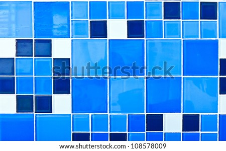 The texture of glossy colorful glazed tile in blue tone.
