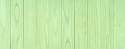 The texture of green from old wooden planks arranged in a vertical order. Background for further design.