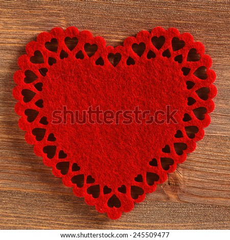 The texture of pure dark brown wood and red decorative heart