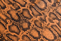 the texture of synthetic leather and brown snakeskin pattern