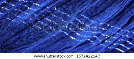 The texture of the background picture, the ornament of the decor, sapphire blue corrugated fabric, fabric with parallel or diagonal folds with serrated folds; products from such a fabric. #1572422149