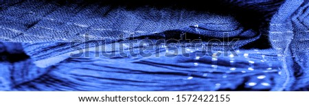 The texture of the background picture, the ornament of the decor, sapphire blue corrugated fabric, fabric with parallel or diagonal folds with serrated folds; products from such a fabric. #1572422155