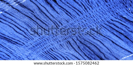 The texture of the background picture, the ornament of the decor, sapphire blue corrugated fabric, fabric with parallel or diagonal folds with serrated folds; products from such a fabric. #1575082462