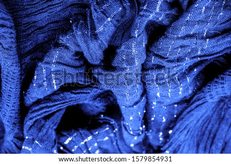 The texture of the background picture, the ornament of the decor, sapphire blue corrugated fabric, fabric with parallel or diagonal folds with serrated folds; products from such a fabric. #1579854931