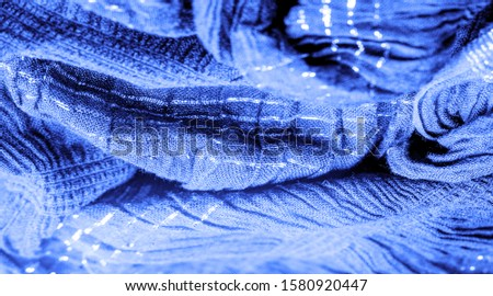 The texture of the background picture, the ornament of the decor, sapphire blue corrugated fabric, fabric with parallel or diagonal folds with serrated folds; products from such a fabric. #1580920447
