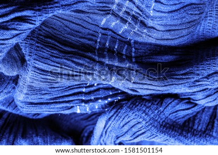 The texture of the background picture, the ornament of the decor, sapphire blue corrugated fabric, fabric with parallel or diagonal folds with serrated folds; products from such a fabric. #1581501154