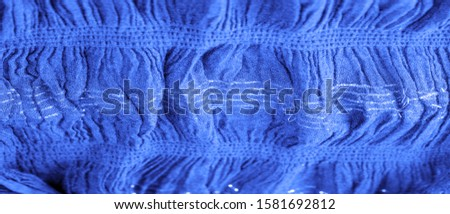 The texture of the background picture, the ornament of the decor, sapphire blue corrugated fabric, fabric with parallel or diagonal folds with serrated folds; products from such a fabric. #1581692812