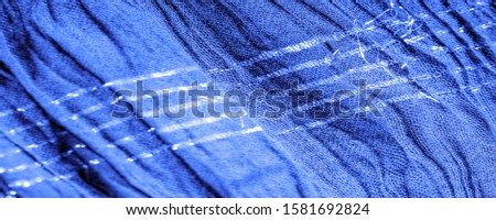 The texture of the background picture, the ornament of the decor, sapphire blue corrugated fabric, fabric with parallel or diagonal folds with serrated folds; products from such a fabric. #1581692824