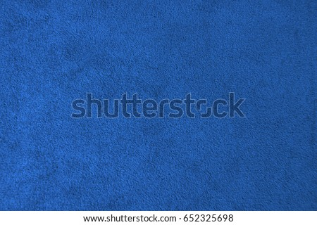 The texture of the blue velvet. The background of blue cloth. Background of blue velvet