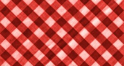 The texture of the bright red of binding gingham fabric. Red textile background. Fabric plaid. Close-up