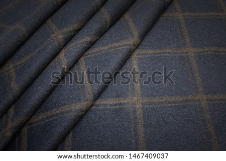 The texture of the cashmere fabric is a brown cage on gray. Background, pattern. #1467409037