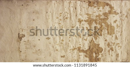 the texture of the cement wall. ...