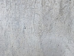 The texture of the dry stucco is made from cement sand.