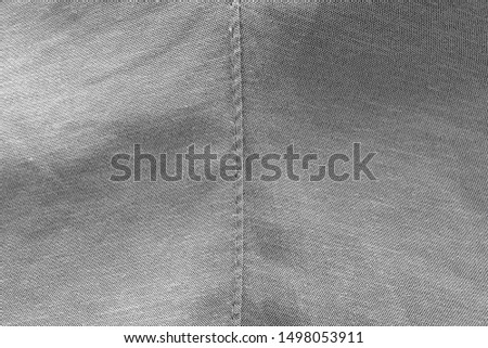 The texture of the fabric with a seam. Fabric for background