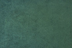 The texture of the  green velvet. The background of green cloth. Background of green velvet