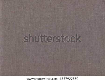 The texture of the grey linen fabric. Background of gray natural gray fabric close-up.