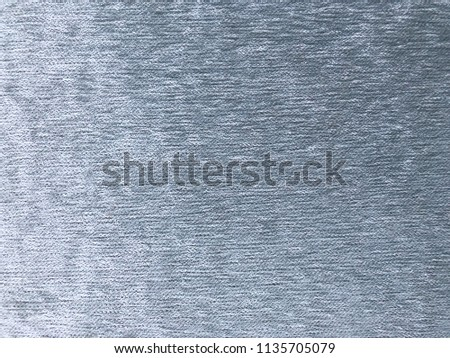 The texture of the grey velvet. The background of grey cloth. Background of grey velvet