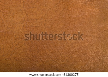 The texture of the old, brown leather. - stock photo