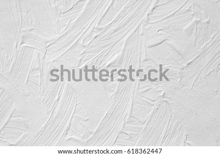 The texture of the paint is white. Wall background with plaster and stains. A screensaver or a postcard for a holiday. #618362447