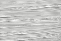 The texture of the paint on a white background. Gouache on canvas stripes.