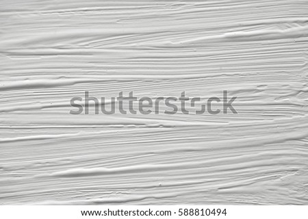 The texture of the paint on a white background. Gouache on canvas stripes. #588810494