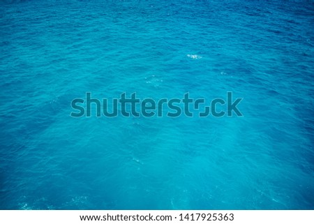 The texture of the perfectly blue water in the ocean. Sea or ocean surface. #1417925363