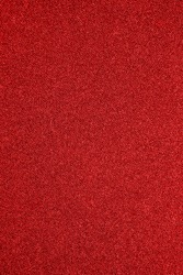 The texture of the red carpet dense.Red fabric background.