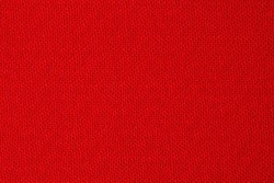 The texture of the red fabric as a background, backdrop close-up. View from above