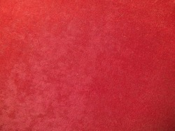 The texture of the red velvet. The background of red cloth. Background of red velvet