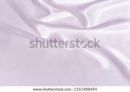 The texture of the satin fabric of lilac color for the background