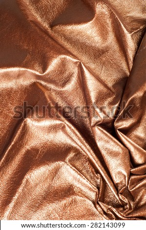 The texture of the skin color. Skin texture, background Golden brown shiny skin