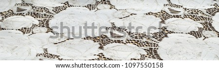 the texture of the skin with embossed floral pattern. abstract vintage leather floral pattern. Leather floral pattern background.  #1097550158