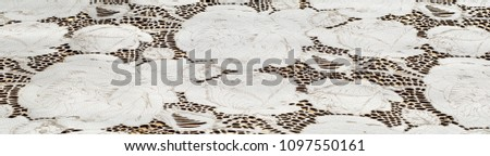 the texture of the skin with embossed floral pattern. abstract vintage leather floral pattern. Leather floral pattern background.  #1097550161