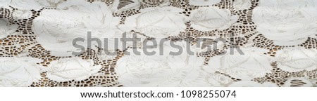 the texture of the skin with embossed floral pattern. abstract vintage leather floral pattern. Leather floral pattern background.  #1098255074