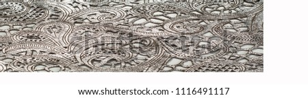 the texture of the skin with embossed floral pattern. abstract vintage leather floral pattern. Leather floral pattern background.  #1116491117
