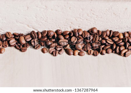 The texture of the smooth layer of wood, a layer of coffee and a layer of rough plaster #1367287964