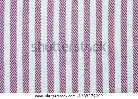 The texture of the striped fabric. Textiles for shirts in lilac stripes. Smooth cloth swatch #1238579959