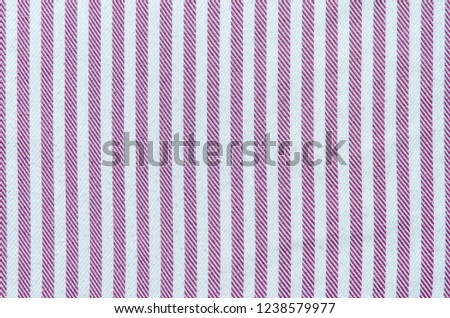 The texture of the striped fabric. Textiles for shirts in lilac stripes. Smooth cloth swatch #1238579977