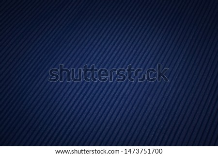 The texture of the synthetic fabric is dark blue. Plisse. Background, pattern. #1473751700